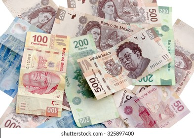 MEXICO CITY / MEXICO - SEPTEMBER 14 2015: Mexican Pesos exchange rate, assorted bills cash pile background