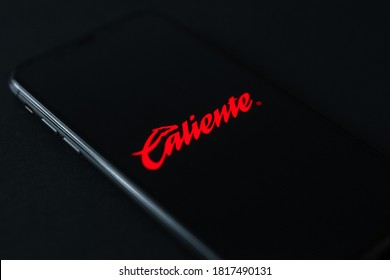 Mexico City / Mexico - September 18 2020: Caliente betting app logo (icon) on the screen mobile phone. Caliente is an online bookmaker registered in Mexico.