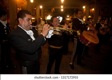 Mexico City - September, 2009. Mariachi musicians play mexican music at Garibaldi Square in Mexico City. This is a place where locals come to celebrate and commiserate with music.