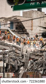 MEXICO CITY, MEXICO - SEPTEMBER 23th 2017: group of courageous volunteers remove debris from collapsed building and search for survivors after a 7.1 earthquake devastated the city on September 19