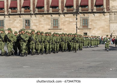 Mexico, Mexico City-09 february 2017: Parade of armed soldiers marching, Zocalo square in Mexico City, Government Palace background