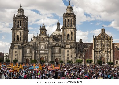 Mexico, Mexico City-29 October 2016: celebration of the dead mexico, view of the  square known as the Zocalo full of people participating in the celebration with costumes , background the cathedral