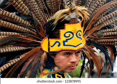 MEXICO CITY-FEB 23:Portrait of Male Aztec Indian wearing traditional clothing and headdress at Zocalo Square on February 23 2010 in Mexico City.Since 1982 the Zocalo become cultural events center