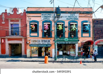 MEXICO CITY,MEXICO - DECEMBER 24, 2016 : Local businesses at a colorful colonial building in Coyoacan, a historic neighborhhod in Mexico City