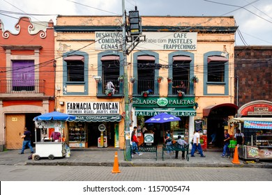 MEXICO CITY,MEXICO - DECEMBER JULY 13,2018 : Local businesses at a colorful colonial building in Coyoacan, a historic neighborhhod in Mexico City