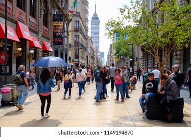 MEXICO CITY,MEXICO - JULY 12,2018 :  People, shops and restaurants at the always busy Madero boulevard in downtown Mexico City
