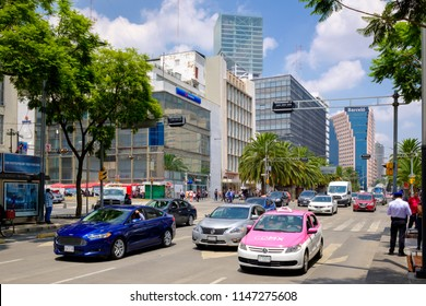 MEXICO CITY,MEXICO - JULY 12,2018 : Urban scene with traditional pink taxis and traffic in downtown Mexico City