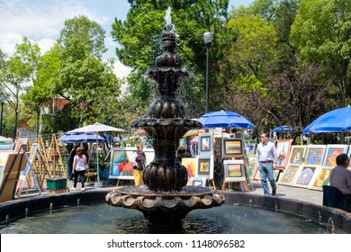 MEXICO CITY,MEXICO - JULY 14,2018 : The famous Saturday Bazaar at the San Angel neighborhood selling paintings and traditional works of art