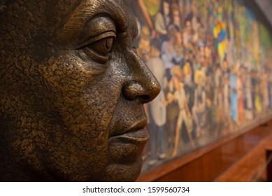 MEXICO DF - May 2019: Bust and mural from Diego Rivera 'El sueño de una tarde dominical en el paseo de la Alameda', or 'Dream of a sunday afternoon in Alameda Park' in the Museo Mural Diego Rivera.