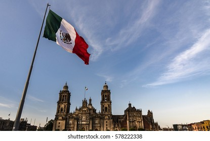 Mexico flag in the wind the background the cathedral in Mexico City