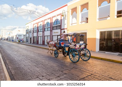 Mexico, January 10, 2018: Horse carriages on a city street in Merida. A coach a picturesque city in Mexico