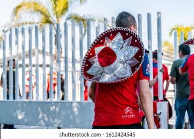 "LEóN, MEXICO - Mar 10, 2019: A Citroen crew member wearing a ""charro"" hat after winning WRC 2019"
