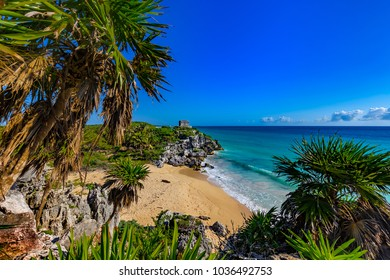 Mexico. The Mayan city of Tulum. There are beach - birthplace of sea turtles and Temple of the God of Wind in the background