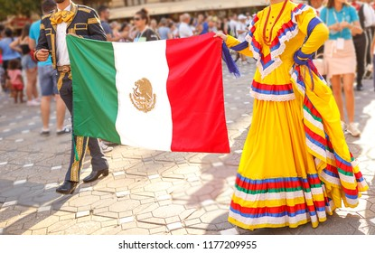 Mexico national costume and flag on parade