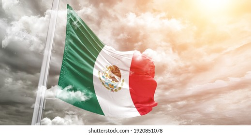 Mexico national flag cloth fabric waving on beautiful grey sky.