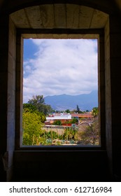Mexico Oaxaca Santo Domingo monastery view from window to town clouds and mountains
