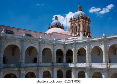 Mexico Oaxaca Santo Domingo monastery courtyard colonnade gallery and church tower with cross