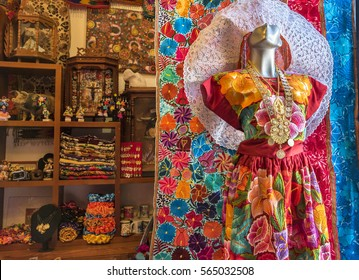 Mexico, Oaxaca-26 January 2017: a Tehuana, manikin with typical dress of the Oaxaca region, made up of cotton and linen fabric, with a necklace of golden coins, background handicraft products