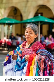 Mexico, Oaxaca-27 January 2017: Indian woman who sells Tehuana clothes, clothes typical of the region of Oaxaca, central Mexico, are dressed in cotton and linen fabric, handicrafts products full of co