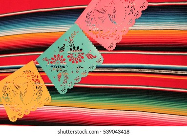Mexico poncho serape background fiesta cinco de mayo paper papel picado decoration bunting flags stock, photo, photograph, image, picture