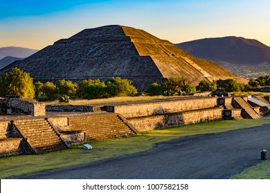 Mexico. Pre-Hispanic City of Teotihuacan (UNESCO World Heritage Site). The Pyramid of the Sun shined in sunset light. There is the Avenue of the Dead in the foreground