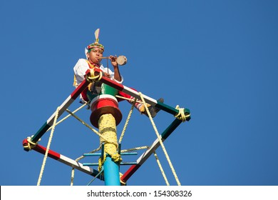"""MEXICO, RIVIERA MAYA, PLAYA DEL CARMEN - MARCH 4: Acrobat performers (Voladores) at """"Flying Men Dance"""" ceremony on March 4, 2013. The ritual in ancient times to please the God of rain."""