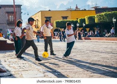 MEXICO - SEPTEMBER 27: Kids playing football soccer at the main square, September 27, 2017 in San Miguel de Allende, Mexico
