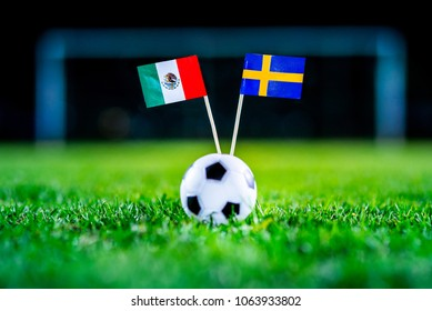 Mexico - Sweden, Group F, Wednesday, 27. June, Football, World Cup, Russia 2018, National Flags on green grass, white football ball on ground.