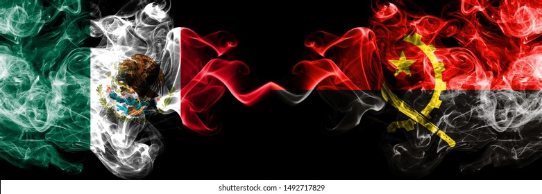 Mexico vs Angola, Angolan smoky mystic flags placed side by side. Thick colored silky abstract smokes banner of Mexican and Angola, Angolan