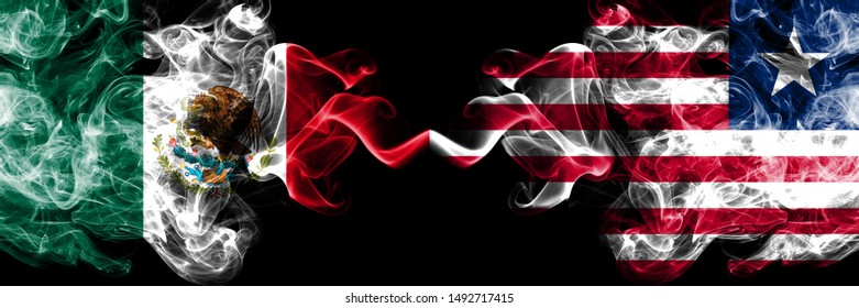Mexico vs Liberia, Liberian smoky mystic flags placed side by side. Thick colored silky abstract smokes banner of Mexican and Liberia, Liberian
