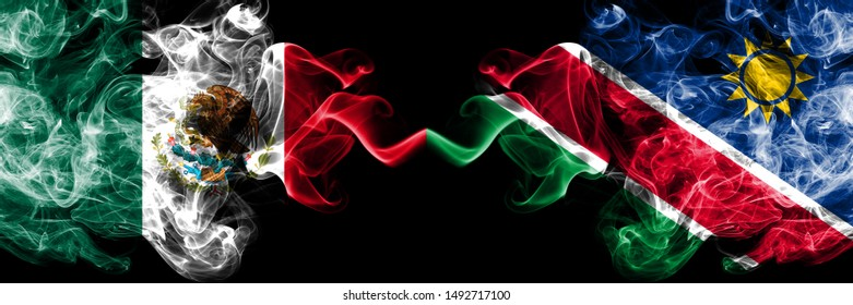 Mexico vs Namibia, Namibian smoky mystic flags placed side by side. Thick colored silky abstract smokes banner of Mexican and Namibia, Namibian