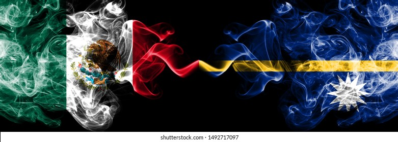 Mexico vs Nauru smoky mystic flags placed side by side. Thick colored silky abstract smokes banner of Mexican and Nauru