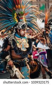 MexicoCity, Mexico - Decembre 22, 2017: Aztec dancers dancing in the Zocalo in Mexico City, DF, Mexico.