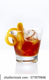 MexiMilan Affair cocktail garnish with orange zest twist served in an old-fashioned glass with crushed ice
