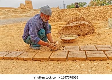 MEYBOD, IRAN - MAY 6, 2015: Clayman making the clay bricks in traditional way in Iran.