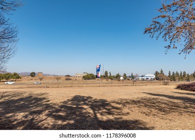 MEYERTON, SOUTH AFRICA, JULY 30, 2018: A blockhouse, dating from the Boer War is visible next to the Blockhouse One Stop near Meyerton in the Gauteng Province. Vehicles are visible on road R59