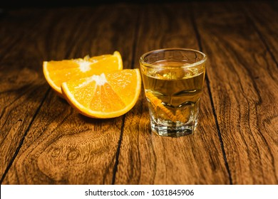 Mezcal mexican drink with orange slices and worm in oaxaca mexico