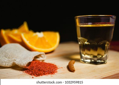 Mezcal mexican drink with orange slices and worm salt in oaxaca mexico
