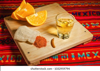 Mezcal mexican drink with orange and worm salt in oaxaca mexico