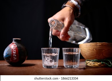 Mezcal, serving shots of mezcal, Oaxacan drink