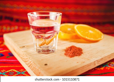 Mezcal shot with orange slices and worm salt in oaxaca mexico