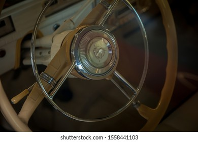 "Mezhigorye, Ukraine - August 24, 2019: The interior of the old car ""Zaporozhets"". Steering wheel of a vintage car. Soviet subcompact car of times of the USSR."