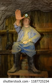 MEZICA, SLOVENIA -  - SEPTEMBER 21th 2018: The upset miner maneken sitting on the toilet in the led and zinc mine museum in Mezica