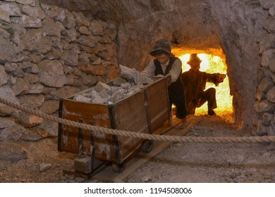 MEZICA, SLOVENIA - SEPTEMBER 21th 2018: Representation of a child pushing the cart in led and zinc mine museum in Mezica