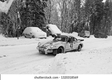 MEZILHAC, FRANCE, February 3, 2019 : Competitors facing the snow on Ardeche roads. Rallye Historique is reserved to those cars which have participated in the Rallye Monte-Carlo before 1980.
