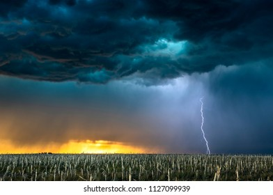 A mezocyclone lightning storm with dark clouds forming over the plains in Tornado Alley, Oklahoma at sunset