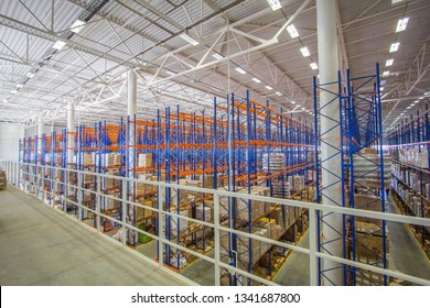 mezzanine and large storage with shelves, goods on the shelves, vertical storage, large storage room