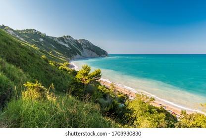 The Mezzavalle beach along the mount Conero coastline near Ancona during the summer (Marche, Italy)