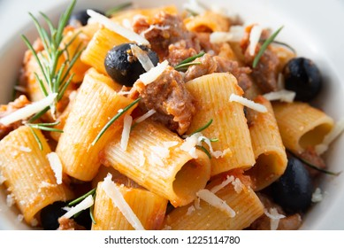 Mezze maniche pasta with sausage, olives and tomato sauce