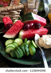 Mezze plate, fruit, vegetables, nuts, hummus and cherries
